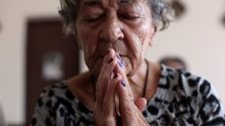 An elderly woman prays at a chapel of the San Rafael nursing home in Arecibo, Puerto Rico February 14, 2018. Picture taken February 14, 2018. REUTERS/Alvin Baez