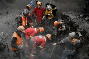 Rescue workers continue to search for human remains, after the eruption of the Fuego volcano, in San Miguel Los Lotes in Escuintla, Guatemala June 14, 2018. REUTERS/Luis Echeverria