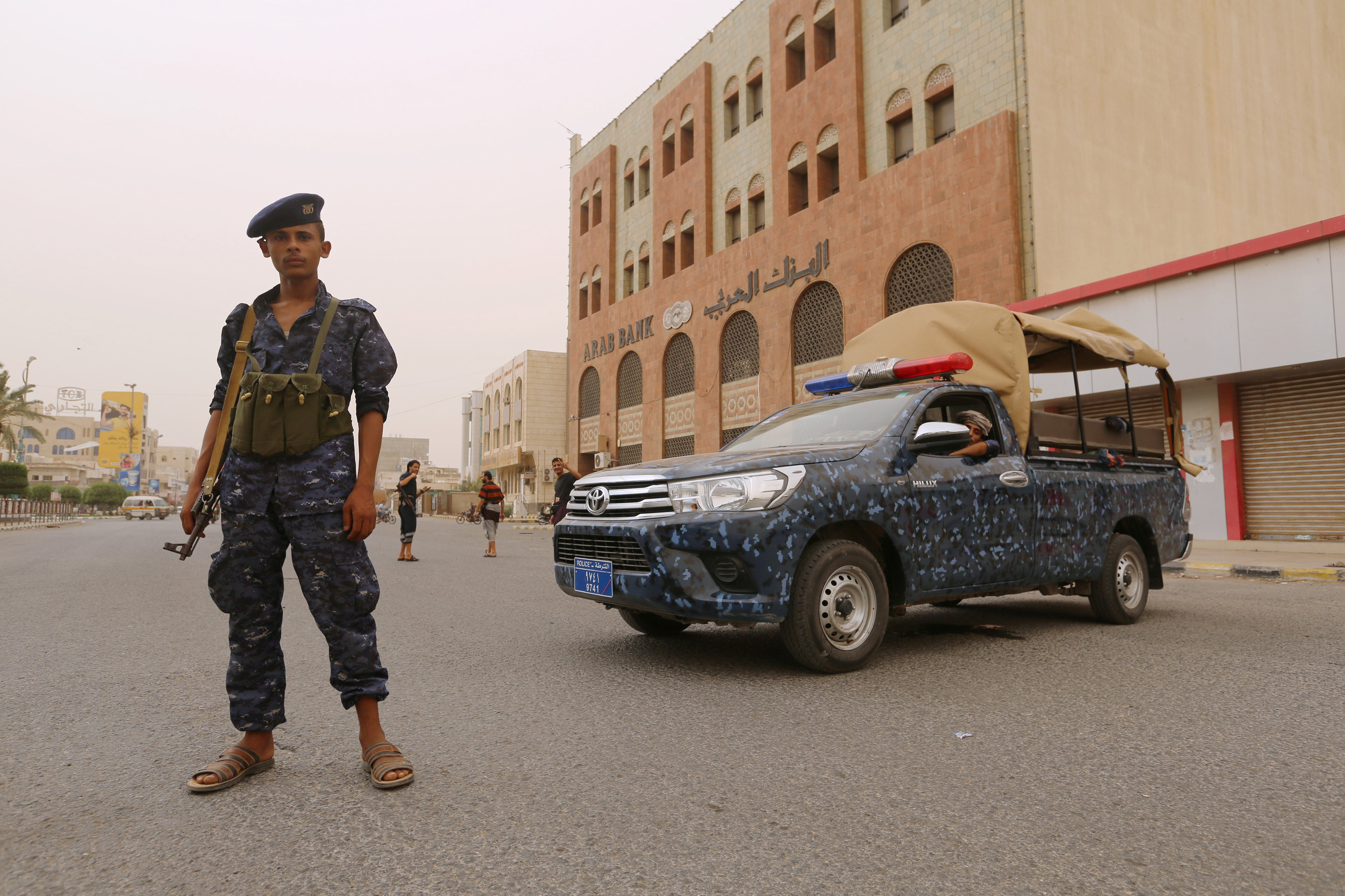 A pro-Houthi police trooper stands past a patrol vehicle in the Red Sea port city of Hodeidah, Yemen June 14, 2018. REUTERS/Abduljabbar Zeyad
