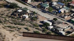 A U.S. border fence between Mexico and the United States ends in the back yard of homes in Juarez, Mexico next to Sunland Park, New Mexico, U.S. June 18, 2018. REUTERS/Mike Blake