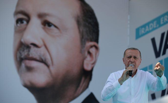 FILE PHOTO: Turkish President Tayyip Erdogan addresses his supporters during an election rally in Ankara, Turkey, June 9, 2018. REUTERS/Umit Bektas/File Photo