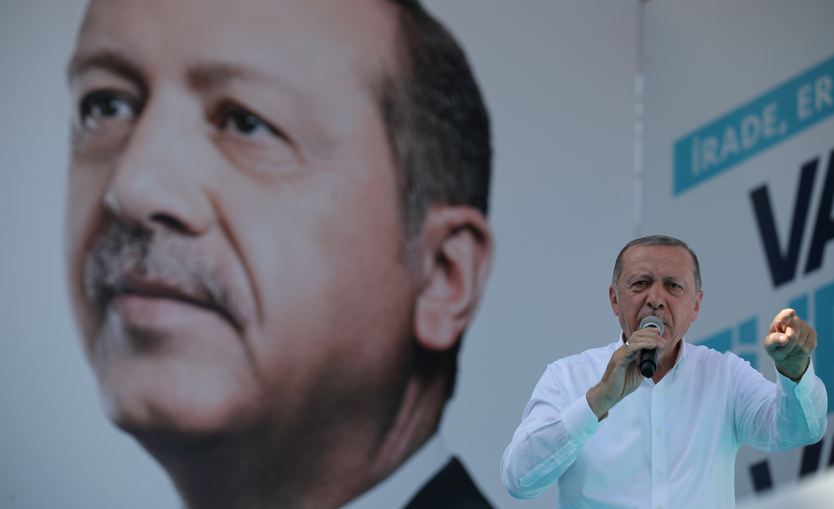 FILE PHOTO: Turkish President Tayyip Erdogan addresses his supporters during an election rally in Ankara, Turkey, June 9, 2018. REUTERS/Umit Bektas/File Photo
