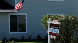 """FILE PHOTO: A """"For Sale"""" sign is seen outside a home in Cardiff, California, U.S. on February 22, 2016. REUTERS/Mike Blake/File Photo"""