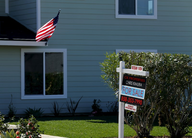 "FILE PHOTO: A ""For Sale"" sign is seen outside a home in Cardiff, California, U.S. on February 22, 2016. REUTERS/Mike Blake/File Photo"