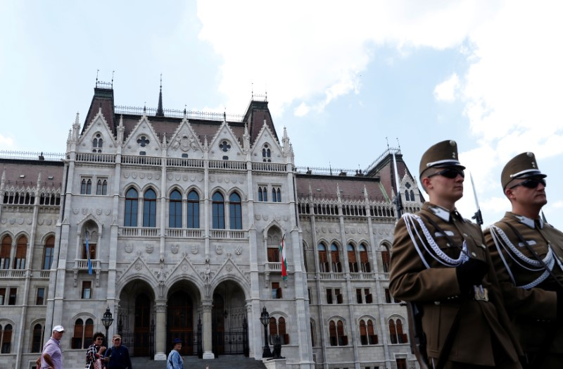 Two soldiers stand in front of the Hungarian Parliament building in Budapest, Hungary, May 29, 2018. REUTERS/Bernadett Szabo