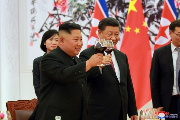 North Korean leader Kim Jong Un and Chinese President Xi Jinping raise a toast in Beijing, China, in this undated photo released June 20, 2018 by North Korea's Korean Central News Agency. KCNA via REUTERS