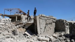 FILE PHOTO: Men inspect a damaged house in Busra al-Harir town, near Deraa, Syria March 13, 2018. REUTERS/Alaa al-Faqir/File Photo