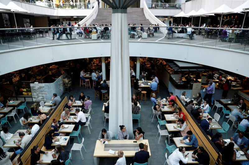 FILE PHOTO: Office workers take their lunch at a food court in Sydney, Australia May 4, 2018. REUTERS/Edgar Su/File Photo