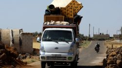 People ride in a truck loaded with belongings in Deraa countryside, Syria June 22, 2018. REUTERS/Alaa al-Faqir