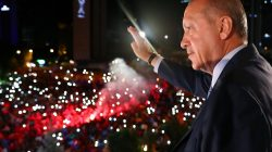 Turkish President Tayyip Erdogan greets his supporters from the balcony of his ruling AK Party headquarters in Ankara, Turkey, early June 25, 2018. Kayhan Ozer/Presidential Palace/Handout via REUTERS