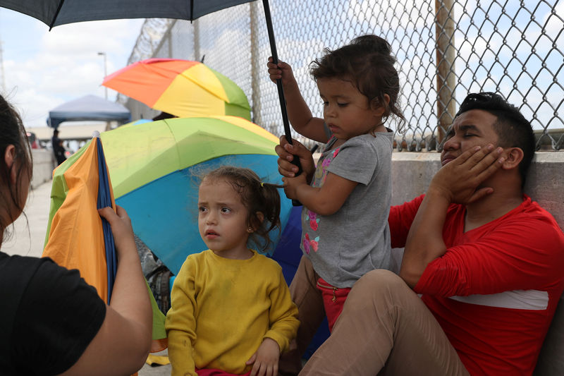 Honduran families seeking asylum wait on the Mexican side of the Brownsville-Matamoros International Bridge after being denied entry by U.S. Customs and Border Protection officers near Brownsville, Texas, U.S., June 24, 2018. REUTERS/Loren Elliott