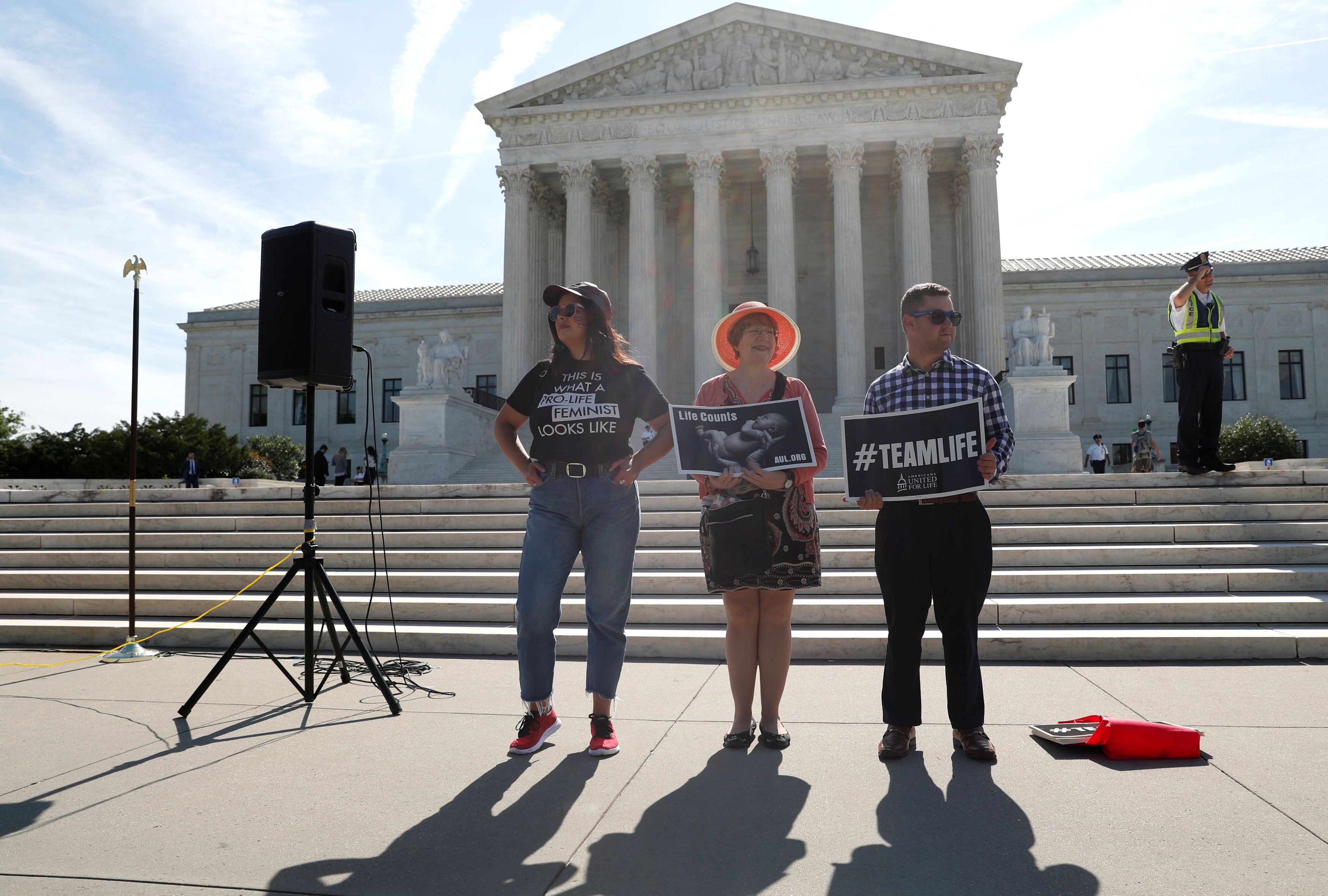 Anti-abortion activists (L-R) Terrisa Bukovinac, Megan Lott and Peter Hinman stand outside of the U.S. Supreme Court in Washington, U.S., June 26, 2018. REUTERS/Leah Millis