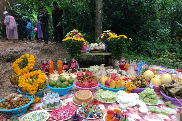 Fruits, desserts and drinks are placed as offerings to the spirits near the Tham Luang caves, where 12 members of an under-16 soccer team and their coach are trapped, in the northern province of Chiang Rai, Thailand, June 26, 2018. REUTERS/Chayut Setboonsarng