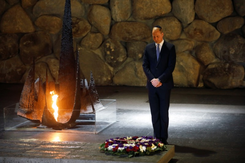 Britain's Prince William pays his respects during a ceremony commemorating the six million Jews killed by the Nazis in the Holocaust, in the Hall of Remembrance at Yad Vashem World Holocaust Remembrance Center in Jerusalem, June 26, 2018. REUTERS/Amir Cohen