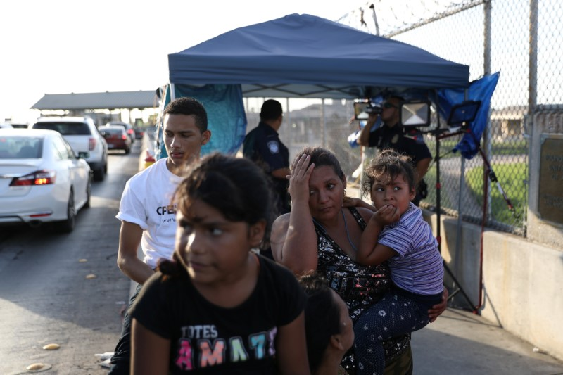 A Honduran family seeking asylum waits on the Mexican side of the Brownsville & Matamoros International Bridge after being denied entry by U.S. Customs and Border Protection officers near Brownsville, Texas, U.S., June 26, 2018. Picture taken June 26, 2018. REUTERS/Loren Elliott