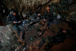 Soldiers take a rest in Tham Luang caves during a search for 12 members of an under-16 soccer team and their coach, in the northern province of Chiang Rai, Thailand, June 27, 2018. REUTERS/Soe Zeya Tun
