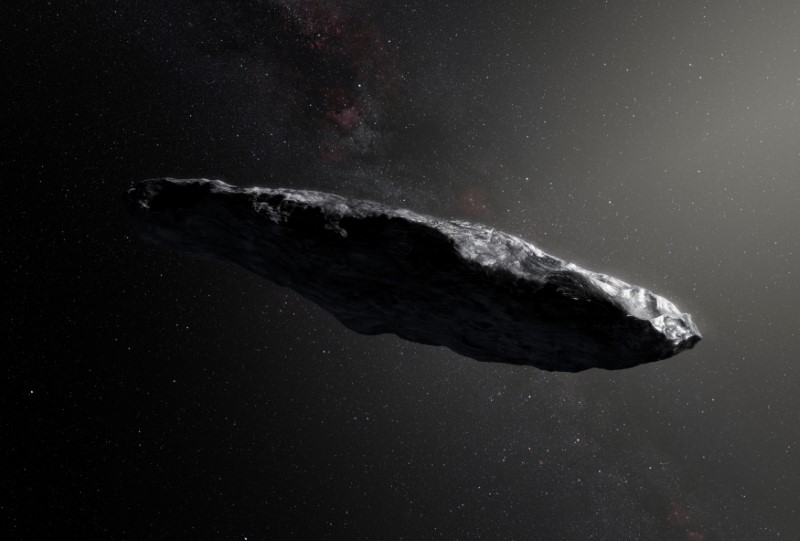 This artist's impression shows the first interstellar asteroid, `Oumuamua as it passes through the solar system after its discovery in October 2017. European Southern Obervatory/M. Kornmesser/Handout via REUTERS