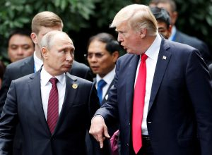 FILE PHOTO: U.S. President Donald Trump and Russia's President Vladimir Putin talk during the family photo session at the APEC Summit in Danang, Vietnam November 11, 2017. REUTERS/Jorge Silva/File Photo