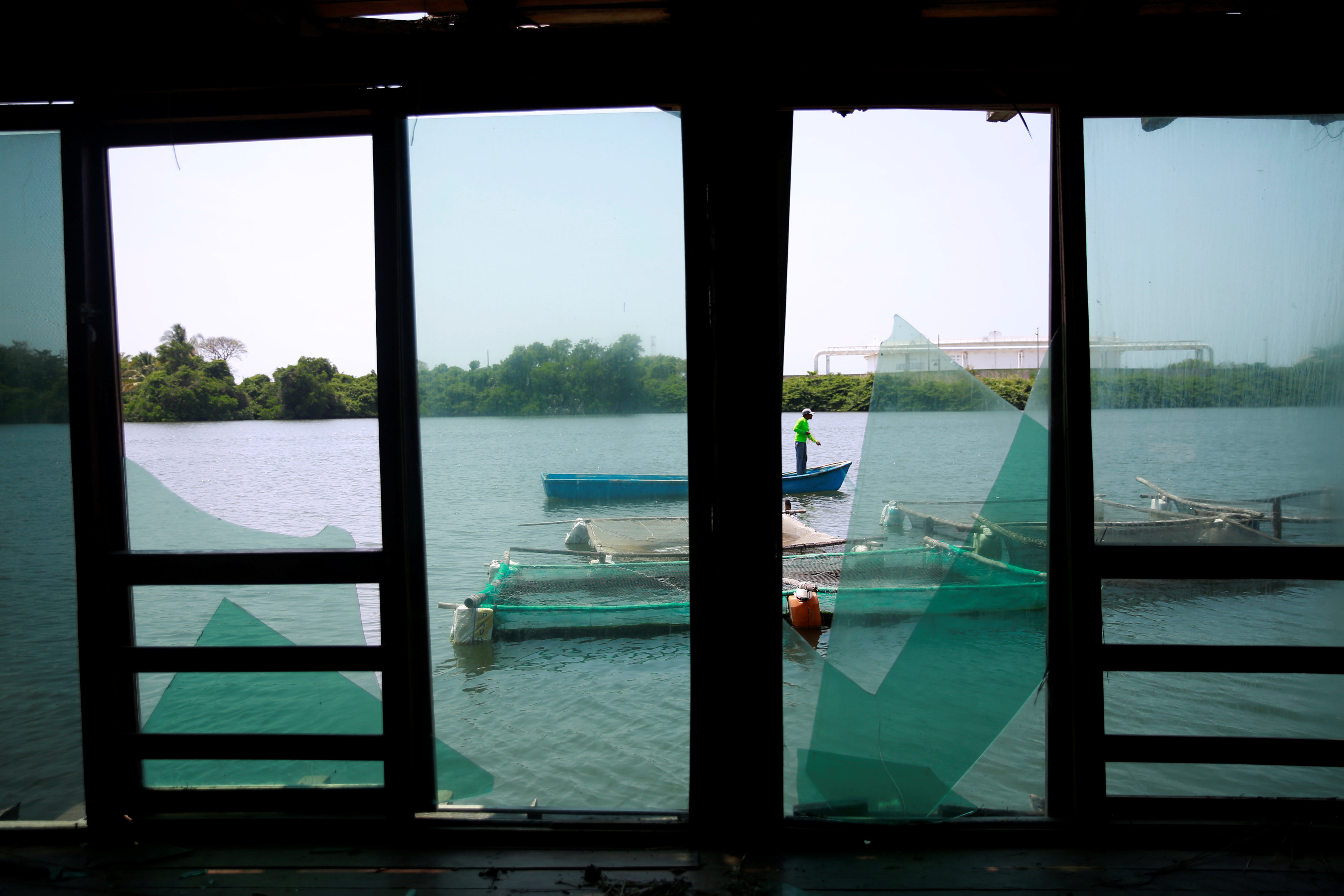 Broken windows of an abandon bar, due to the local violence are seen in front of the Pemex oil port known as Dos Bocas en Paraiso, Tabasco, Mexico April 24, 2018. Picture taken on April 25, 2018. REUTERS/Carlos Jasso