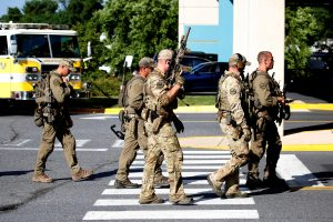 Special tactical police gather after a gunman opened fire at the Capital Gazette newspaper, killing at least five people and injuring several others in Annapolis, Maryland, U.S., June 28, 2018. REUTERS/Joshua Roberts