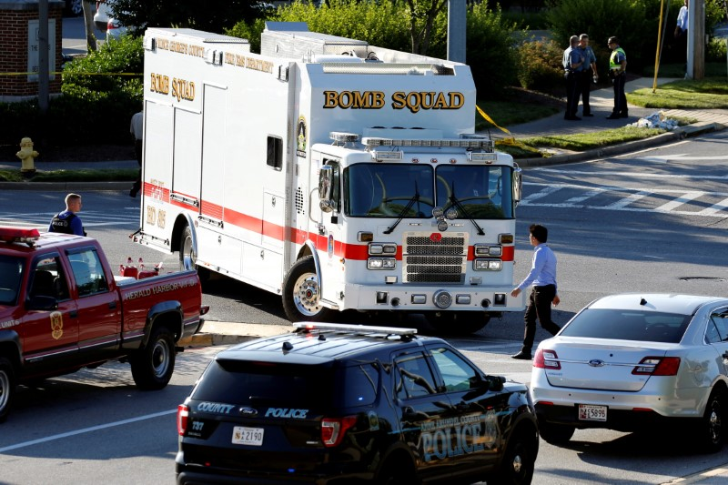 Emergency response vehicles drive near a shooting scene after a gunman opened fire at the Capital Gazette newspaper in Annapolis, Maryland, U.S., June 28, 2018. REUTERS/Joshua Roberts