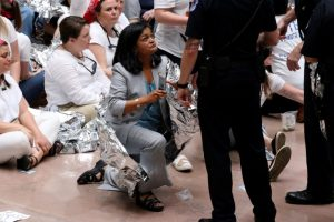 "U.S. Capitol Police direct U.S. Representative Pramila Jayapal (D-WA) to stand for arrest as she joined demonstrators calling for ""an end to family detention"" and in opposition to the immigration policies of the Trump administration, at the Hart Senate Office Building on Capitol Hill in Washington, U.S. June 28, 2018. REUTERS/Jonathan Ernst"