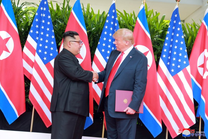 U.S. President Donald Trump shakes hands with North Korean leader Kim Jong Un at the Capella Hotel on Sentosa island in Singapore in this picture released on June 12, 2018 by North Korea's Korean Central News Agency. KCNA via REUTERS/File Phot