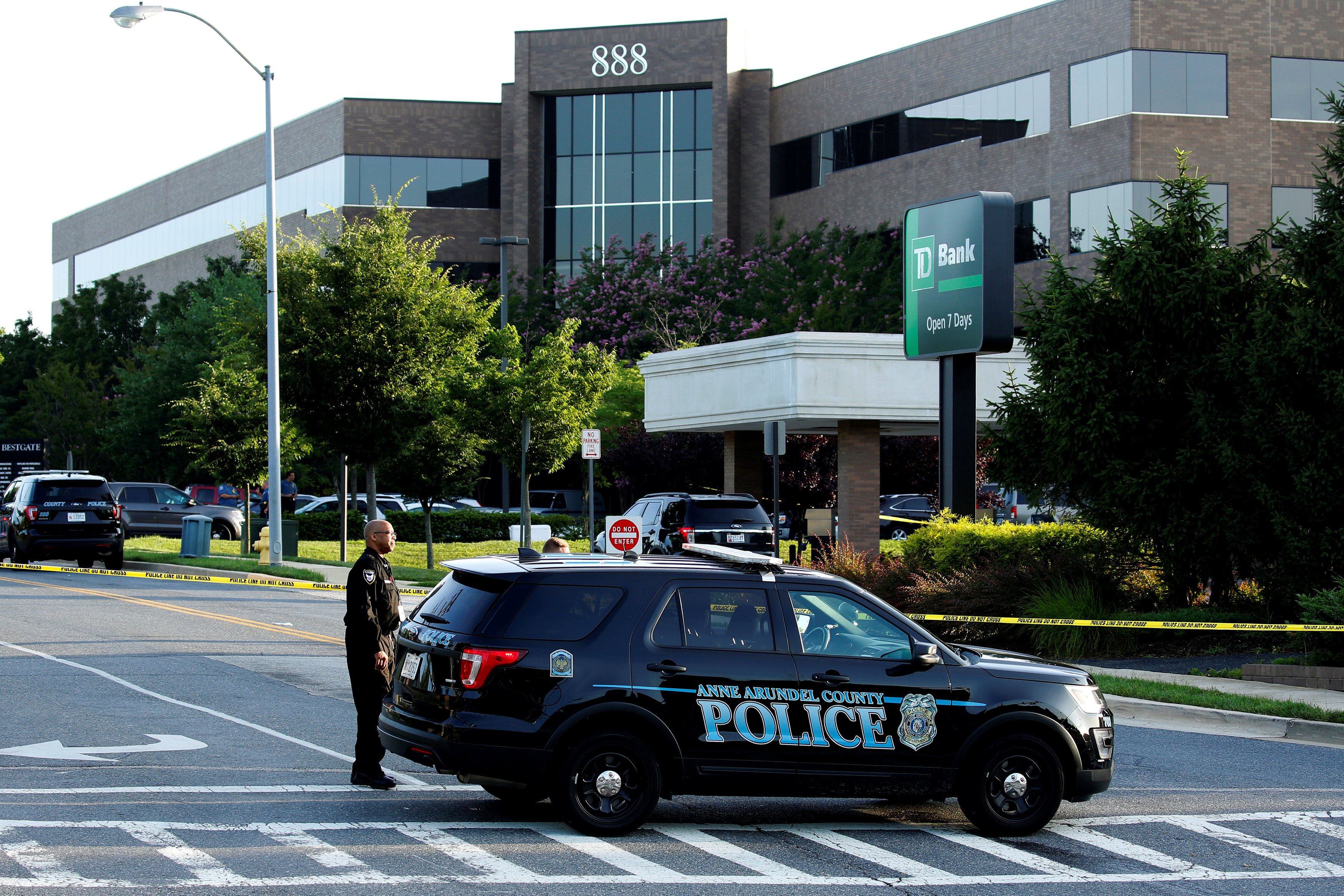 A police car blocks the road in front of the Capital Gazette a day after a gunman opened fire at the newspaper, killing five people and injuring several others in Annapolis, Maryland, U.S., June 29, 2018. REUTERS/Joshua Roberts