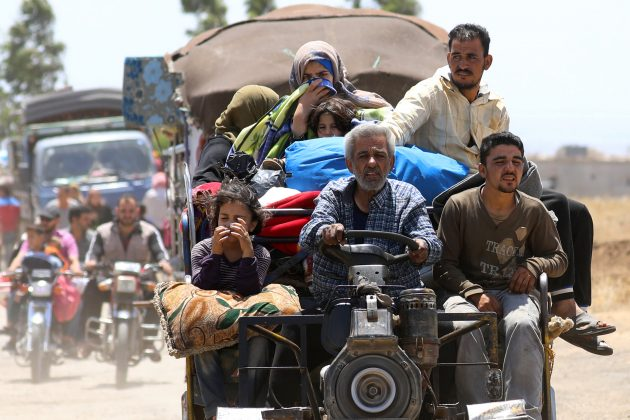 Internally displaced people from Deraa province arrive near the Israeli-occupied Golan Heights in Quneitra, Syria June 29, 2018. REUTERS/Alaa Al-Faqir/File Photo