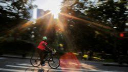A woman rides a bike on a hot summer day in Central Park, Manhattan, New York, U.S., July 1, 2018. REUTERS/Eduardo Munoz