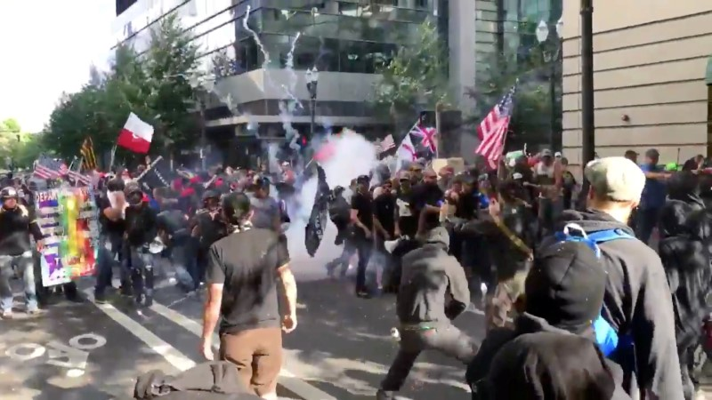 Protesters of the right-wing group Patriot Prayer clash with protesters from anti-fascist groups during a demonstration in Portland, Oregon, U.S. June 30, 2018, in this still image taken from video from obtained from social media. MANDATORY CREDIT. Bryan Colombo/via REUTERS