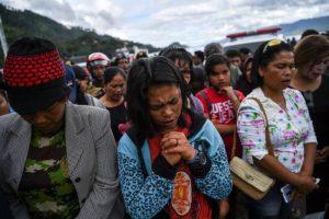 Relatives of missing passengers of a ferry that sank at Lake Toba pray in Simalungun, North Sumatra, Indonesia July 1, 2018. Antara Foto/Sigid Kurniawan/via REUTERS