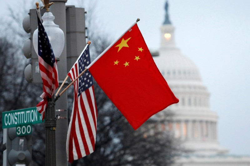 FILE PHOTO: The People's Republic of China flag and the U.S. Stars and Stripes fly on a lamp post along Pennsylvania Avenue near the U.S. Capitol during Chinese President Hu Jintao's state visit, in Washington, D.C.,U.S., January 18, 2011. REUTERS/Hyungwon Kang/File Photo