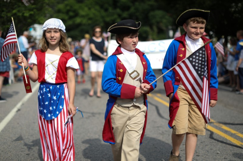 Children in costumes march down Main Street during the annual Fourth of July parade in Barnstable Village on Cape Cod, Massachusetts, U.S., July 4, 2018. REUTERS/Mike Segar