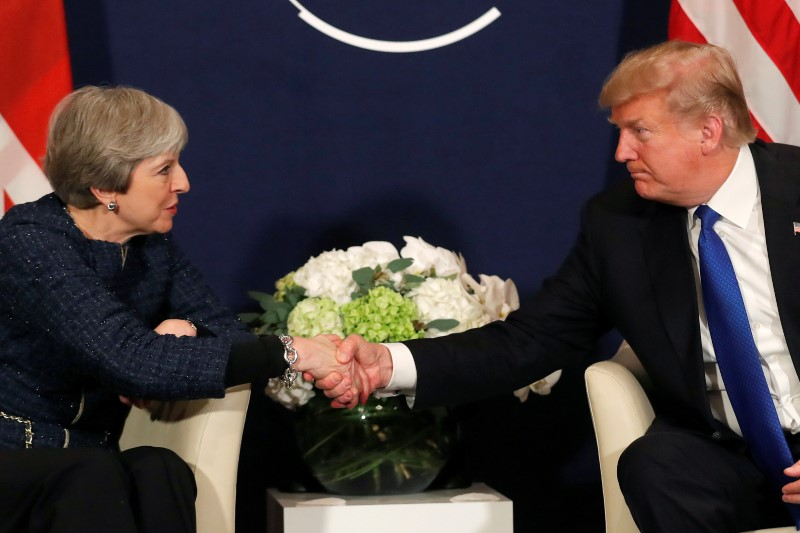FILE PHOTO: U.S. President Donald Trump shake hands with Britain's Prime Minister Theresa May during the World Economic Forum (WEF) annual meeting in Davos, Switzerland, January 25, 2018. REUTERS/Carlos Barria/File Photo