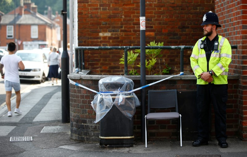 A police officer guards a cordoned off rubbish bin on Rolleston Street, after it was confirmed that two people had been poisoned with the nerve-agent Novichok, in Salisbury, Britain, July 5, 2018. REUTERS/Henry Nicholls