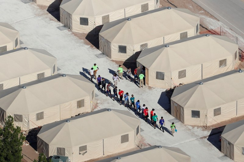 "FILE PHOTO: Immigrant children, many of whom have been separated from their parents under a new ""zero tolerance"" policy by the Trump administration, are being housed in tents next to the Mexican border in Tornillo, Texas, U.S., June 18, 2018. REUTERS/Mike Blake/File Photo"