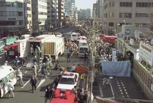 The injured of the deadly gas attack are treated by rescue workers near Tsukiji subway station in Tokyo, in this photo taken by Kyodo March 20, 1995. Mandatory credit Kyodo/via REUTERS