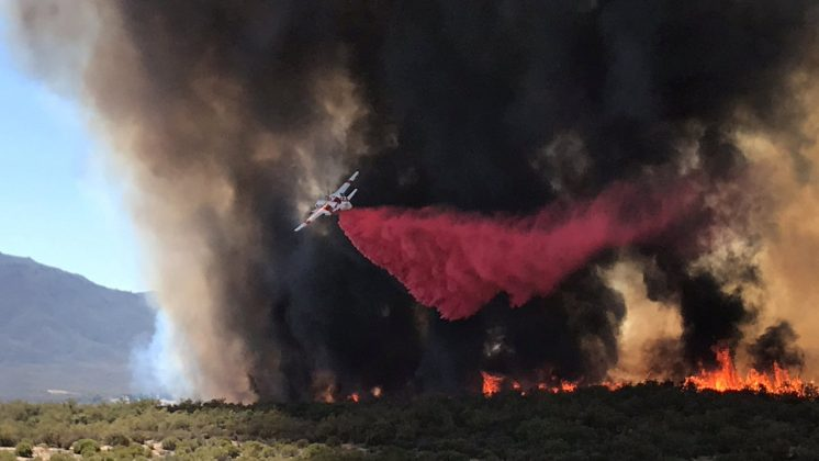 "An air tanker drops retardant on wildfire called ""BentonFire"" near off Benton Road and Crams Corner Drive in this image on social media in Anza in Riverside County, California, U.S., July 4, 2018. Courtesy California Department of Forestry and Fire Protection/Handout via REUTERS"