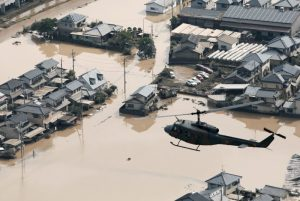 A helicopter flies over Mabi town which was flooded by the heavy rain in Kurashiki, Okayama Prefecture, Japan, in this photo taken by Kyodo July 9, 2018. Mandatory credit Kyodo/via REUTERS