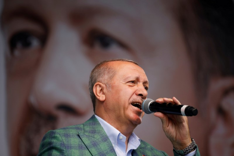 FILE PHOTO: Turkish President Tayyip Erdogan addresses his supporters during an election rally in Istanbul, Turkey, June 23, 2018. REUTERS/Alkis Konstantinidis/File Photo