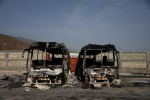 Two burnt buses are seen inside the customs facilities in Malpasse, Haiti, July 8, 2018. REUTERS/Andres Martinez Casares