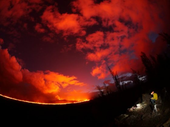 A USGS geologist making observations of the fissure 8 lava channel at sunset is pictured in this July 3, 2018 fisheye lens handout photograph near the Kilauea volcano eruption in Hawaii, U.S. USGS/Handout via REUTERS