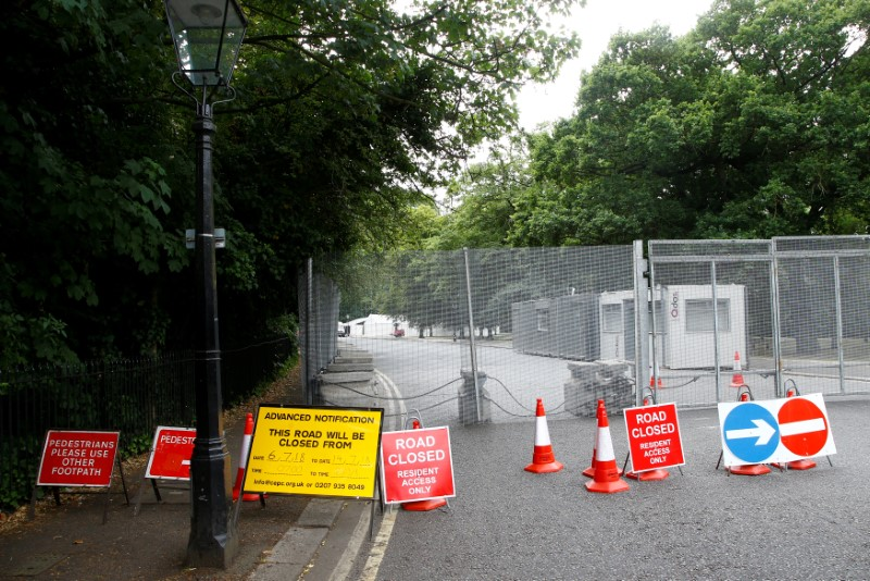 Temporary signs indicate road closures around the U.S. ambassador's residence, where special fences have been erected prior to the U.S. presidential visit at the end of the week, in Regent's Park in London, Britain, July 10, 2018. REUTERS/Henry Nicholls
