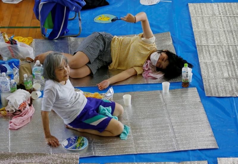 Local residents take rest at Okada elementary school acting as an evacuation center in Mabi town in Kurashiki, Okayama Prefecture, Japan, July 10, 2018. REUTERS/Issei Kato