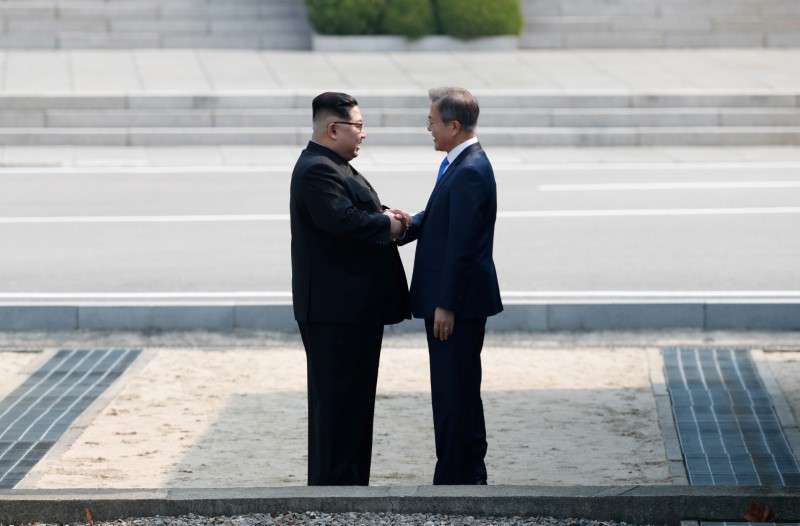 FILE PHOTO - South Korean President Moon Jae-in and North Korean leader Kim Jong Un meet in the truce village of Panmunjom inside the demilitarized zone separating the two Koreas, South Korea, April 27, 2018. Korea Summit Press Pool/Pool via Reuters