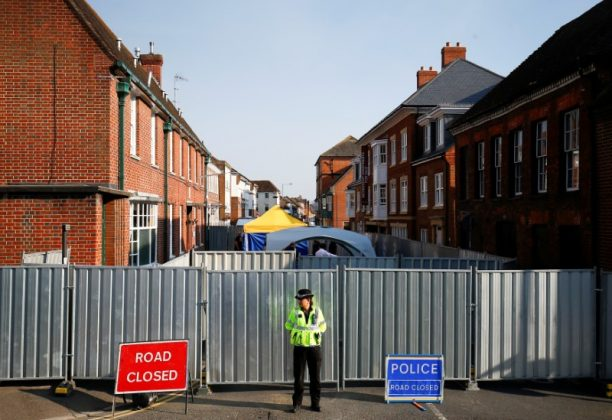 FILE PHOTO: A police officer stands in front of screening erected behind John Baker House, after it was confirmed that two people had been poisoned with the nerve-agent Novichok, in Amesbury, Britain, July 5, 2018. REUTERS/Henry Nicholls/File Photo