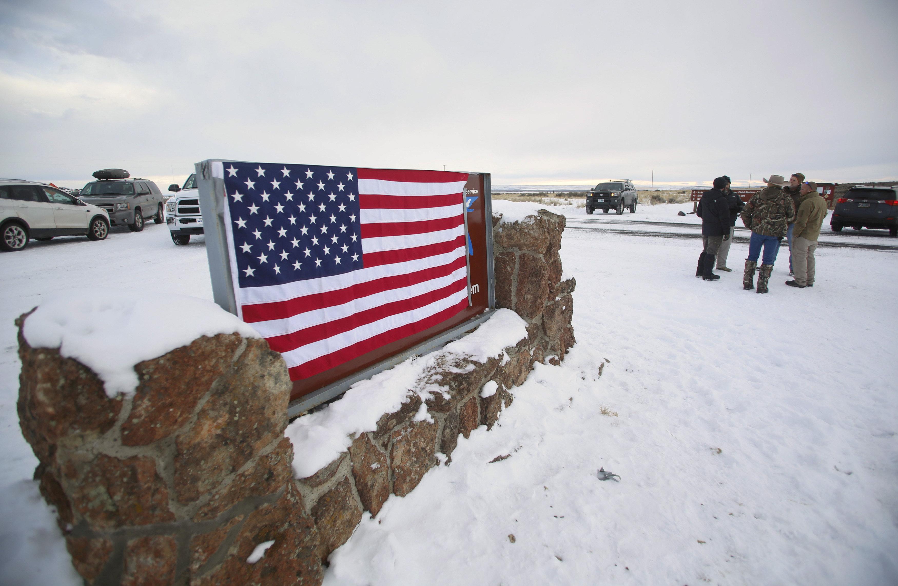 FILE PHOTO: A U.S. flag covers a sign at the entrance of the Malheur National Wildlife Refuge near Burns, Oregon, U.S. January 3, 2016. REUTERS/Jim Urquhart/File Photo