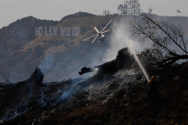 Firefighters work on a fire near the landmark Griffith Observatory in the hills overlooking Los Angeles, California, U.S. July 10, 2018. REUTERS/Patrick T. Fallon