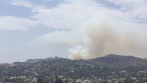 Smoke rises from a brush fire near the Giffith Observatory in Los Angeles, United States, in this still image taken from a July 10, 2018 video footage by Elizabeth West obtained from social media. Elizabeth West/Social Media/via REUTERS
